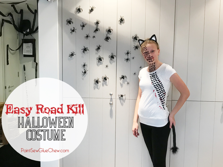 Halloween costume and spider decorations